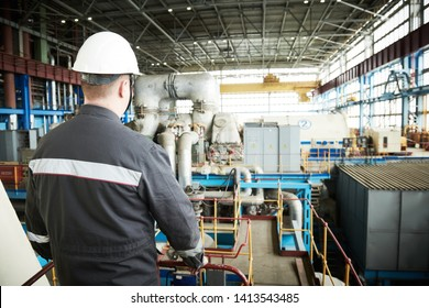 Power plant maintenance. Industial worker engineer