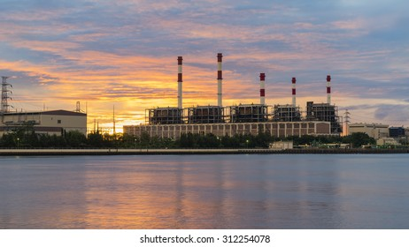 power plant at riverside during sunrise
