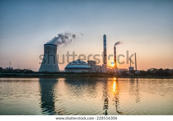 power plant with the setting sun , industrial landscape , hdr picture