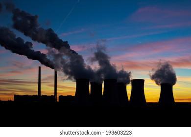 Power plant silhouette on evening sky