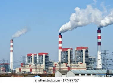 power plant with smoke from its stacks