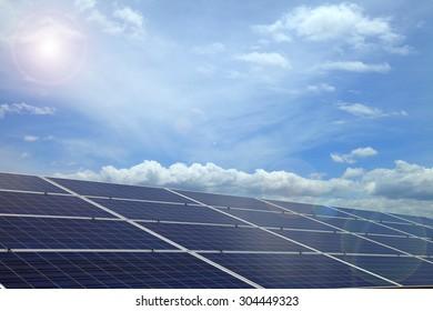 Power plant using renewable solar energy on blue sky cloud with sun.