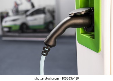 power plug of an electric vehicle charging station is waiting for the next car to charge