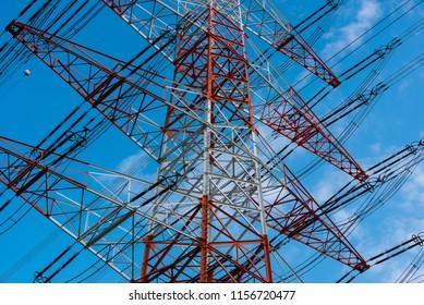 Power pole against blue sky