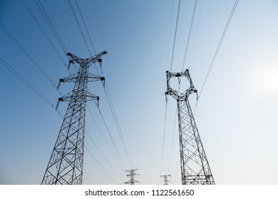 power pylon against a blue sky