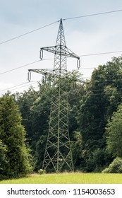 Power pylon on the green field