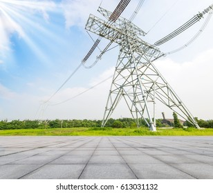 Power pylons and high voltage lines in an agricultural landscape