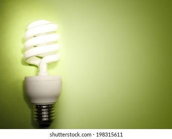 Power saving light bulb on green
