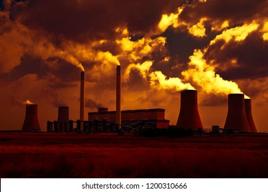Power station in the golden glow of sunset.  South Africa and pollution