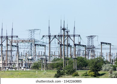Power station, high voltage wires are against the sky. Power lines. High voltage power pylons