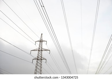 Power stations and wires against the sky. Environment and industry.
