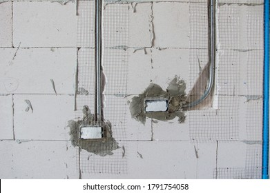 Power steel boxes and electrical metal conduit for cable or network wiring installation embed in plaster loft brick wall background for industry technology underground work isolated with clipping path
