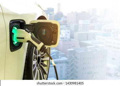 Power supply connect to electric car for add charge to the battery. Charging re technology industry transport which are the future of the Automobile on blurred city background.