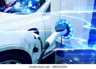 Power supply connect to electric vehicle for charge to the battery. Charging technology industry transport which are the futuristic of the Automobile. EV fuel Plug in hybrid car. - Shutterstock ID 1083131954