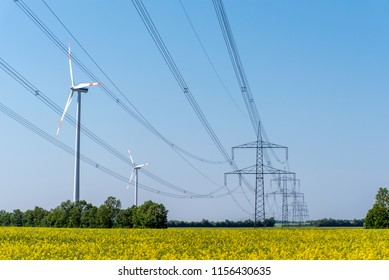 Power supply lines and some wind turbines seen in rural Germany