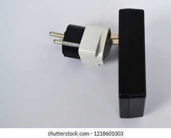 Power supply unit or battery charger for an electrical network with a voltage of 110 volts and a 220 volt adapter on a white background close up