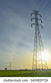 power tower across rice field