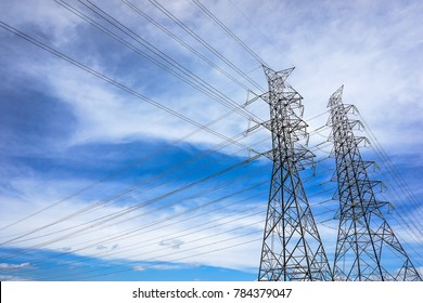 power tower and transmission lines on cloudy sky background