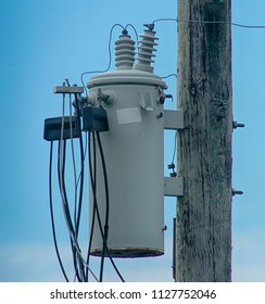 power transformer on top of a power pole