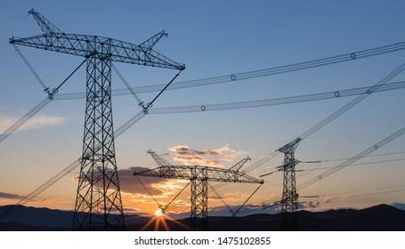 power transmission pylon in sunrise, electric tower silhouette background