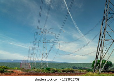 Power transmission tower in the middle of the sugar cane plantation, beautiful blue sky