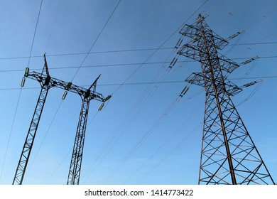 Power transmission towers against the blue sky