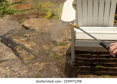 Power washing an adirondack chair