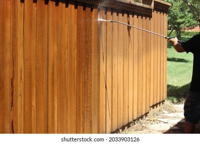 Power washing the fence prior to re-staining, high pressure cleaning, pressure washing fence, do it yourself house repairs, cleaning old dirty fence boards