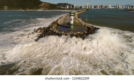 The power of the waves challenge a breakwater (Itajai, Brazil)