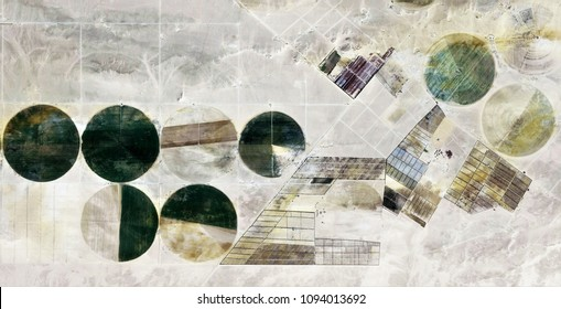 The power of the wind, farms of human crops in the desert, tribute to Pollock, abstract photography of the deserts of Africa from the air, bird's eye view, abstract expressionism, contemporary art,