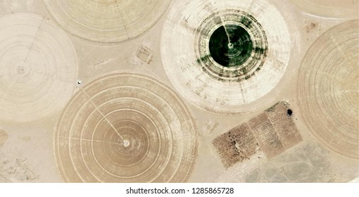 The power of the wind, farms of human crops in the desert,tribute to Pollock, abstract photography of the deserts of Africa from the air, aerial view, abstract expressionism, contemporary art,