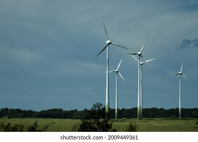 Power of wind turbine generating electricity clean energy with cloud background on the sky.Global ecology.Clean energy concept save the world. High quality photo