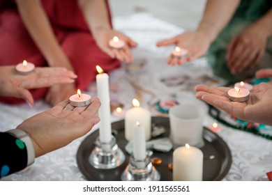 the power of the women's circle, girls hold candles in their hands