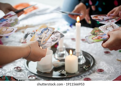 the power of the women's circle, girls hold candles in their hands, cards and candles