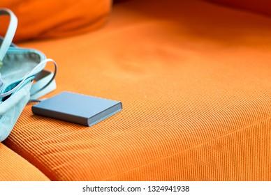 Powerbank charging smartphone on sofa
