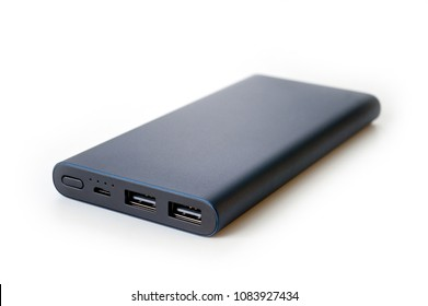 Powerbank  new, powerful dark color with two usb inputs on a white background