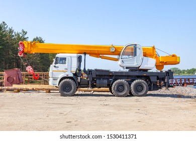 Powerful 25 ton truck crane in transport position on a dirt site