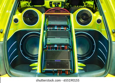 A powerful audio system with amplifiers speakers and lcd monitors in the car trunk.