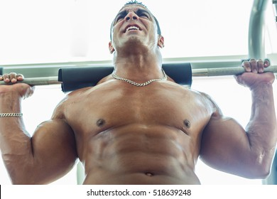 Powerful bodybuilder heavy lifting at the gym.
