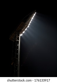 powerful bright large tall outdoor stadium spotlights on working with dark sky background