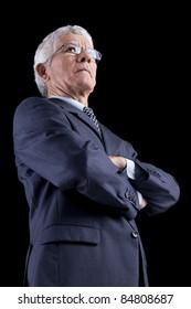Powerful businessman portrait (isolated on black)