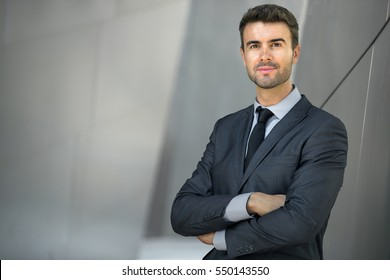 Powerful CEO portrait male business man corporate staff executive with arms crossed
