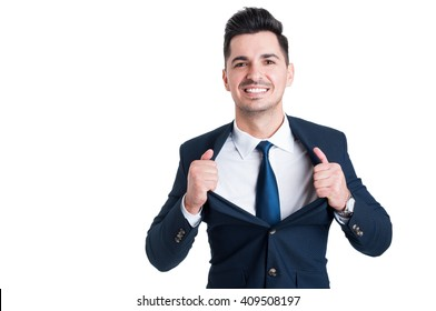 Powerful and confident young salesman opening his suit jacket as superhero metaphor
