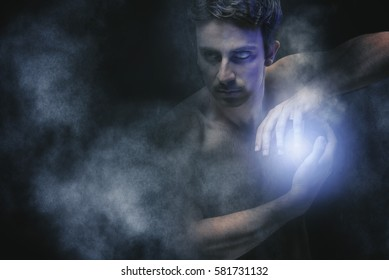 Powerful dark sorcerer casting a spell, making a magic orb