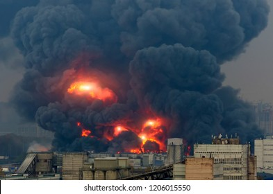 Powerful explosion with bright flashes and black smoke in the city