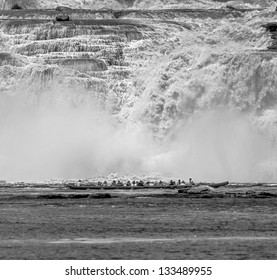 The powerful falls and tourists boat in the lagoon of the Canaima national park - Venezuela, South America (black and white)
