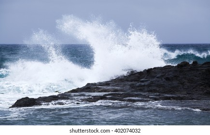 powerful foamy ocean waves breaking by the shores of Gran Canaria