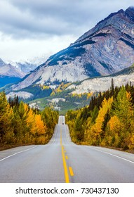 "Powerful granite Rockies of Canada. The road 93 ""Icefields Parkway"" passes among the snow-capped mountains.  The concept of active and automobile tourism"