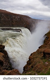 Powerful Gullfoss waterfall and its canyon in a cloudy day, Iceland