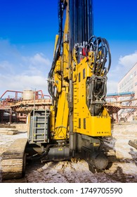 Powerful hydraulic drilling rig. Drilling and piling. Foundations in construction. Geology. Vibratory immersion.
